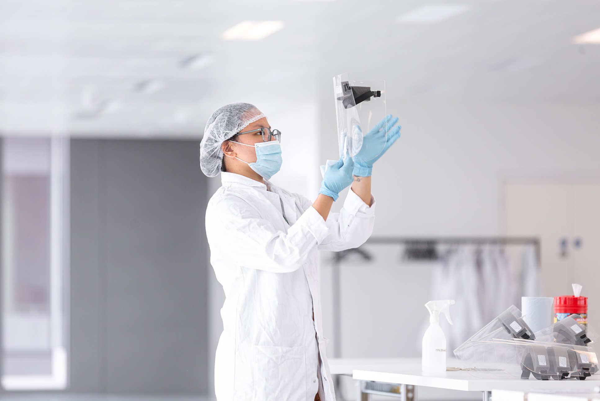 Women inspecting visor